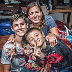 joyful foursome (Pejasar) Tags: escuelaintegrada guatemala antigua students boys administrator string play happy joyful smiles
