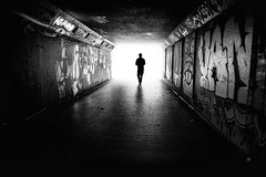 tunnel silhouette (Daz Smith) Tags: dazsmith fujixt20 fuji xt20 andwhite bath city streetphotography people candid portrait citylife thecity urban streets uk monochrome blancoynegro blackandwhite mono bristol graffiti mural man male silhouette tunnel light black white