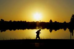 Sunrise on Woodlawn Lake (Flagman00) Tags: sanantoniotx woodlawn lake public park sunrise reflection runner jogger art sol soleil orange