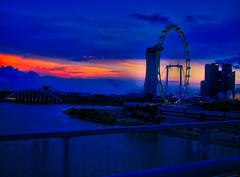 Sunset In Singapore (MarkRosauer) Tags: singapore sunset marinabay singaporeflyer ferriswheel clouds
