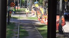 At Work on St. Charles St. (en tee gee) Tags: roadwork trolley streetcar neworleans workers
