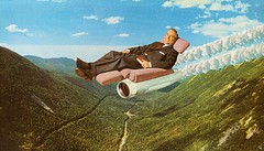 iohs (woodcum) Tags: man chair armchair reactive turbine fly flying sitting book sky high collage surreal grain retro vintage smiling hills
