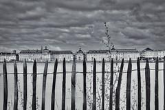 L'autre rive. (vues_de_mon_balcon) Tags: city fleuve river ville bordeaux france placedelabourse unesco blackandwhite bw cloud nuage ciel garonne fences