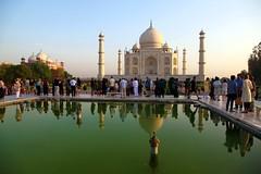 The Taj Mahal. Tourists and reflections (Heaven`s Gate (John)) Tags: tajmahal taj mahal india agra architecture art sunshine blue sky water reflections tourists people johndalkin heavensgatejohn white marble unesco worldheritagesite history heritage 10faves 25faves
