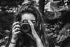Nikon's world of Black and White (Stoyan_Slavkov) Tags: girl longhair brunet black thinking sitting green outside fun cliffs nikon whire white blackandwhite