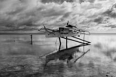 BS0I9924 (jeridaking) Tags: kite flyer kids child play mono monotone outrigger boat fisherman reflection sea sky horizon clouds ralph matres jeridaking foretheloveofphotography sulangan samar guiuan visayas people