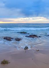 Cloudy Sunrise Seascape (Merrillie) Tags: daybreak portraitlandscape sand landscape nature water newsouthwales rocks nsw blue beach scenery waves seaweed clouds newport earlymornings waterscape sea australia dawn seascape