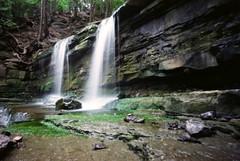 pinholed falls (.grux.) Tags: holga120wpc pinhole film mediumformat expiredfilm 120 fujireala100 6x9 waterfalls rock nature green moss princesslouise orléans