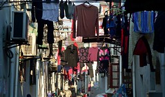 Shanghai - Hung out to dry (cnmark) Tags: china shanghai nong long lao ximen laoximen narrow alley street lane clothes lines socks towels boots coat hung out hanging old city town 中国 上海 老西们 ©allrightsreserved
