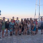 Honors students get a group picture together at a port next to the sea in Greece.
