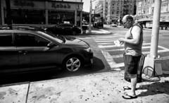Into the Trash (Robert S. Photography) Tags: bw monochrome street scene summer man standing sidewalk trashcan shishkebab memo restaurant brooklyn kingshighway nyc sony dscwx150 iso100 july 2017