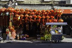 Chinese Lanterns (Keith Kelly) Tags: asia cambodia chineselanterns chinesenewyear kh kampuchea phnompenh seasia southeastasia aroundtown capital cart city drinkvendor gold lantern lanterns red shop street
