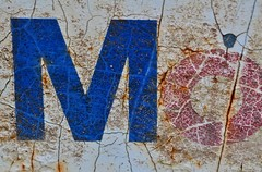Mo (part 1 of 2) (holly hop) Tags: texture macro mo bil mobil oil brand logo ghostsign signsunday patina rust sign sliderssunday hss