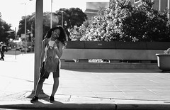 Dreaming, I Must Be Dreaming (burnt dirt) Tags: houston texas downtown city town street sidewalk crosswalk girl woman man people person couple group crowd asian latina cute sexy laugh smile jeans dress shorts skirt yogapants tights leggings stockings friend longhair shorthair ponytail heels stilettos boots shadow blonde brunette reflection athlete construction traffic lunch office building worker streetphotography documentary portrait fujifilm xt1 bw blackandwhite bike bicycle model young tattoo metro bus busstop train trainstop glasses sunglasses