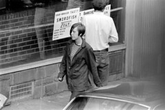 h42-68 07 (ndpa / s. lundeen, archivist) Tags: nick dewolf nickdewolf bw blackwhite photographbynickdewolf film monochrome blackandwhite city summer 1968 1960s 35mm boston massachusetts candid streetphotography citylife streetlife people beaconhill charlesstreet sidewalk pedestrian youngpeople july sunday weekend july28 pedestrians storefront business car vehicle automobile parkedcar woman youngwoman man youngman window storewindow restaurant sign signs special specials charlesstreetsteakhouse brunette charbroiled tasty swordfish