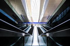 Escalator Lines (CoolMcFlash) Tags: modern escalator city citylife person futuristic architecture lines geometry leadingline vienna austria fujifilm xt2 rolltreppe stadt futuristisch architektur linien geometrie fluchtpunkt pov perspective perspektive wien österreich fotografie photography hauptbahnhof xf 1024mm f4 r ois symmetry symmetrisch