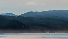 Heceta Head Lighthouse (Nktnorton) Tags: lighthouse mountain trees coast sky ocean water shore nautical oregon pacific