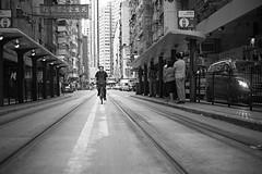 Hong Kong cyclist (Bjarne Erick) Tags: bike bicycle hongkong street tracks earlymorning
