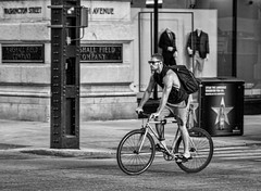 Bike ride..... (Kevin Povenz Thanks for the 3,200,000 views) Tags: 2017 july kevinpovenz illinios chicago downtown morning earlymorning early bike biker male blackandwhite bw canon7dmarkii sigma24105art sigma24105 street streetphotography pavement wheel wheels shorts summer backpack streetcorner riding