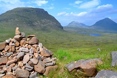 Torridon (heathernewman) Tags: mountains scotland torridon cairn uk bluesky rock grass water green blue northwestscotland