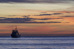 Boat on the water (JWY80) Tags: fourthofjuly naples beach gulfofmexico ocean fishingboat tranquil bluehour goldenhour sunset