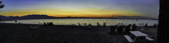Sunset at Lake Tahoe      (Pano) (joe Lach) Tags: sunset laketahoe southlaketahoe beach chairs mountain boats picnictables trees sky orange blue horizon tahoebeachandskiclub california panoramic panorama water waterpictorial joelach night dusk sundown