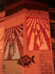 Austin - Piranha (Drriss & Marrionn) Tags: austin austintx texas usa outdoor travel streetviews street streetscene streetlife urbanjungle citytrip eastsixthibizdistrict building buildings city vivid nightshot evening graffiti stickerart art