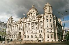 Port of Liverpool Building. (gilli1812) Tags: minolta x570 35mm film kodak colorplus 200 maritime port northwest england pierhead historic seaport mersey river clouds sky moody analogue 50mm md lens