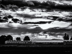 Greenhouse... (Ody on the mount) Tags: abendlicht anlässe architektur em5ii fototour himmel licht mzuiko6028 omd olympus schwäbischealb wolken bw monochrome sw glashaus gewächshaus drama blackandwhite greenhouse clouds light evening architecture