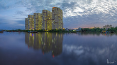 Evening in Saigon (talkbyheart_sweet) Tags: reflection water architecture sky city no person river building travel outdoors skyscraper lake office skyline daylight downtown cityscape modern urban waterfront landscape vietnam saigon evening