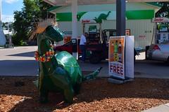 Decorated dinosaur at Sinclair (paulrosemeyer) Tags: sinclair dinosaur greensinclairdinosaur greyeagle minnesota americana