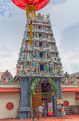 The Sri Mariamman Temple, Singapore (Ray in Manila) Tags: singapore srimariammman temple chinatown hindu placeofworship umbrella people red lantern colourful te ple agamic tower architecture