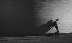 Kamppi Sunset (Fake Truth) Tags: 2870 autofocus finland handheld helsinki kamppi kit sonya7 steadyshot bw blackandwhite monochrome sunset man standing dark lowkey