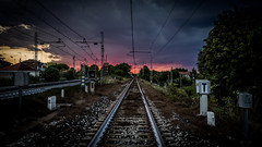 Red sky at night, sailor's delight (voxpepoli) Tags: rimini tramonto cielo sky rail train binari sunset railway