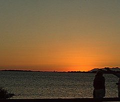 Sola..... al tramonto (dona(bluesea)) Tags: sunset sea donnasola womanalone sicilia sicily tristezza sadness solitudine solitude salinemarsala marsala