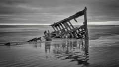 Sunset at Peter Iredale 1 B+W (Jerry Fornarotto) Tags: abandoned bw beach blackandwhite boat clouds coast decay disaster dramatic historical iredale iron jerryfornarotto landscape longexposure moody northwest oceansunset old oldship oregon oregoncoast outdoors pacific pacificnorthwest peteriredale reflection remains ruins rust rusted scene sea ship shipwreck shore skeleton sky steel storm sunset travel vessel warrenton water waves west western wreck