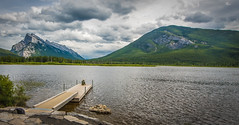 Fishing in a mountain Paradise (tibchris) Tags: banff banffnationalpark panorama landscape fishing vermillionlake lake alberta canada dock mountains clouds