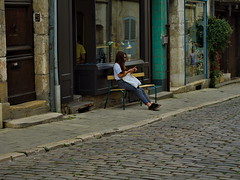Lonely Girl (Luigidenoel) Tags: alone girl lonely sitting street streetphotography door rock wood green cute phone waiting waitingforfriend bourges
