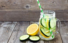 Lemon cucumber detox water in a mason jar glass with straw and slices against a rustic wood background (thienkhanh2017) Tags: detox water lemon cucumber mason jar glass healthy wood wooden rustic fruit spa cleanse cleansing background vintage fresh slice drink cold food freshness beverage closeup green natural refreshment nutritious health organic nutrition diet summer close delicious dieting lifestyle nutrient vegetarian vitamins up yellow sliced vegetable mug straw striped paper canada