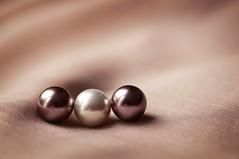 Three pearls (JossieK) Tags: pearls macromondays three minimalist textile texture spheres balls fabric taupe