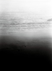(Andrea Mori Marchetti) Tags: ocean sea dark black sand white film pellicola holga 120mm shadow water double exposure outdoor italy spain melancholy sadness far sky sunset panorama andrea mori marchetti light lights infinite angel nature outside reflection acqua paesaggio