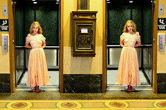 A Strange Encounter on the 27th Floor of The Liselotte Salonin Hotel (Studio d'Xavier) Tags: werehere flippingphotos theliselottesaloninhotel hotel elevators surreal symmetry twins eviltwins elevator availablelight