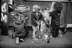 graffiti kids (Daz Smith) Tags: dazsmith fujixt20 fuji xt20 andwhite bath city streetphotography people candid portrait citylife thecity urban streets uk monochrome blancoynegro blackandwhite mono art spray paint mural graffiti kids fun painting