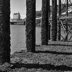 The Grand Hotel Llandudno (Mister Oy) Tags: davegreen oyphotos ©oyphotos llandudno mvbalmoral pier jetty moored hotel grandhotel mono monochrome blackandwhite bw fujix100f shadows wales welsh cymru through gap abstract