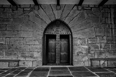 The crusader's church / La iglesia del cruzado (Luis DLF) Tags: crusader navarra church cruzado piedra stone blackandwhite wood madera steel hierro casco helmet bright
