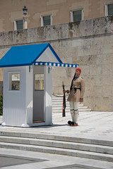 A presidential guard at his post on Syntagma square in Athens, Greece (wuestenigel) Tags: post athens greece syntagmasquare presidentialguard uniform architecture diearchitektur building gebäude outdoors drausen people menschen city stadt home zuhause military militär street strase travel reise man mann religion daylight tageslicht house haus police polizei door durch pavement pflaster woman frau election wahl noperson keineperson battle schlacht