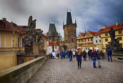 Crossing the Charles Bridge in Prague, Czech Republic (` Toshio ') Tags: toshio prague czechrepublic europe european europeanunion charlesbridge people bridge architecture history fujixe2 xe2 statues street city travel storm winter december