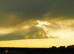 storm passing (ekelly80) Tags: montana bozeman june2017 roadtrip keisgoesusa drive sky clouds storm rain passing cloudshelf sun sunshine rays glow golden evening light