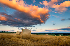 Harvest Time (jo.haeringer) Tags: sunset clouds sky haybales cereals corn grain field landscape nature alsace france fuji xt2