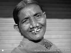 2016-12d Jeypore Tribal Market (22) (Matt Hahnewald) Tags: ©matthahnewaldphotography facingtheworld photography photo image faceperception physiognomy psychological amazing dynamic lively favourite superior interesting nikond3100 nikkorafs50mmf18g primelens 50mmlens 43aspectratio horizontalformat street portraiture portrait closeup headshot fullfaceview tiltedhead outdoor blackandwhite monochrome worldcultures cultural character personality realpeople humanhead humanface humaneyes laughingeyes nose nosepiercing nosejewellery nosestuds goldandgemstonenosejewellery facialexpression eyecontact bareheaded blanket blanketovershoulder consent empathy rapport respect encounter emotion fun ethnicportrait travelportrait tribalportrait tribalmarket marketwoman adivasiwoman jeypore orissa india middleagedwoman oneperson posing authentic smiling laughing incredible happy cheerful softfocus